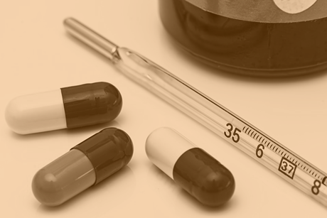 Pills and thermometer